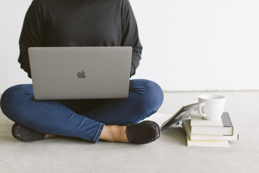 image of woman holding a computer on lap