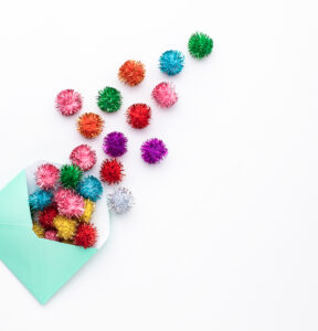 pom poms and an envelope