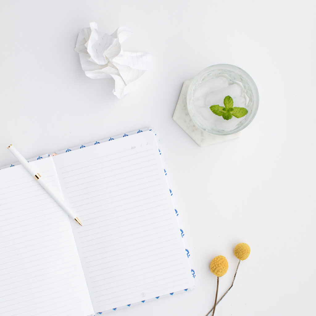 notebook and water glass