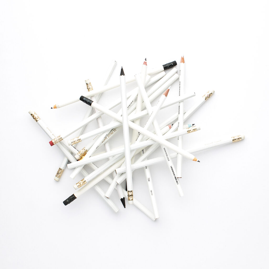 a pile of white pencils
