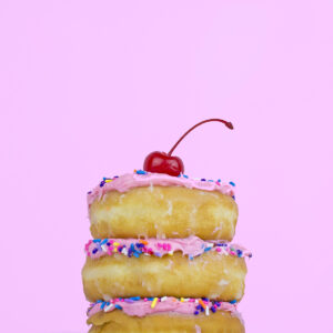 donuts stacked with cherry on top