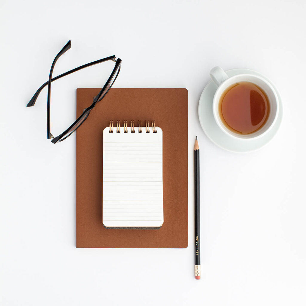 notebook, glasses, coffee